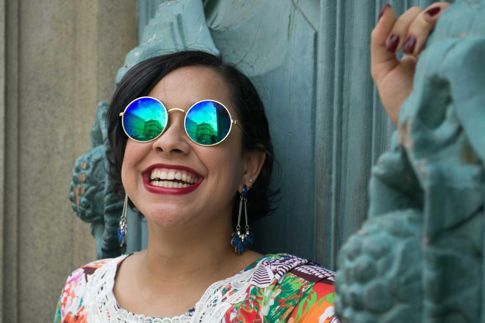Smiling woman wearing sunglasses | happy, smiling, beautiful, fashion