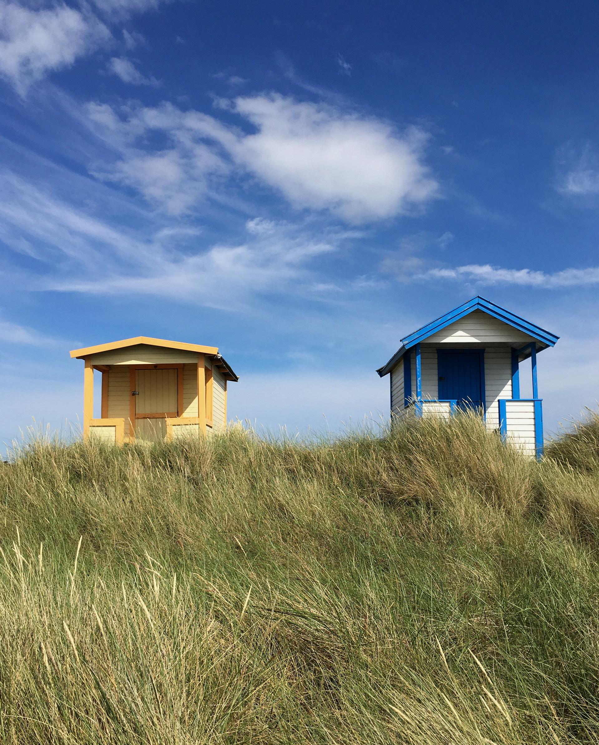 Beach huts in Skanör. | piapising, architecture, blue sky, countryside
