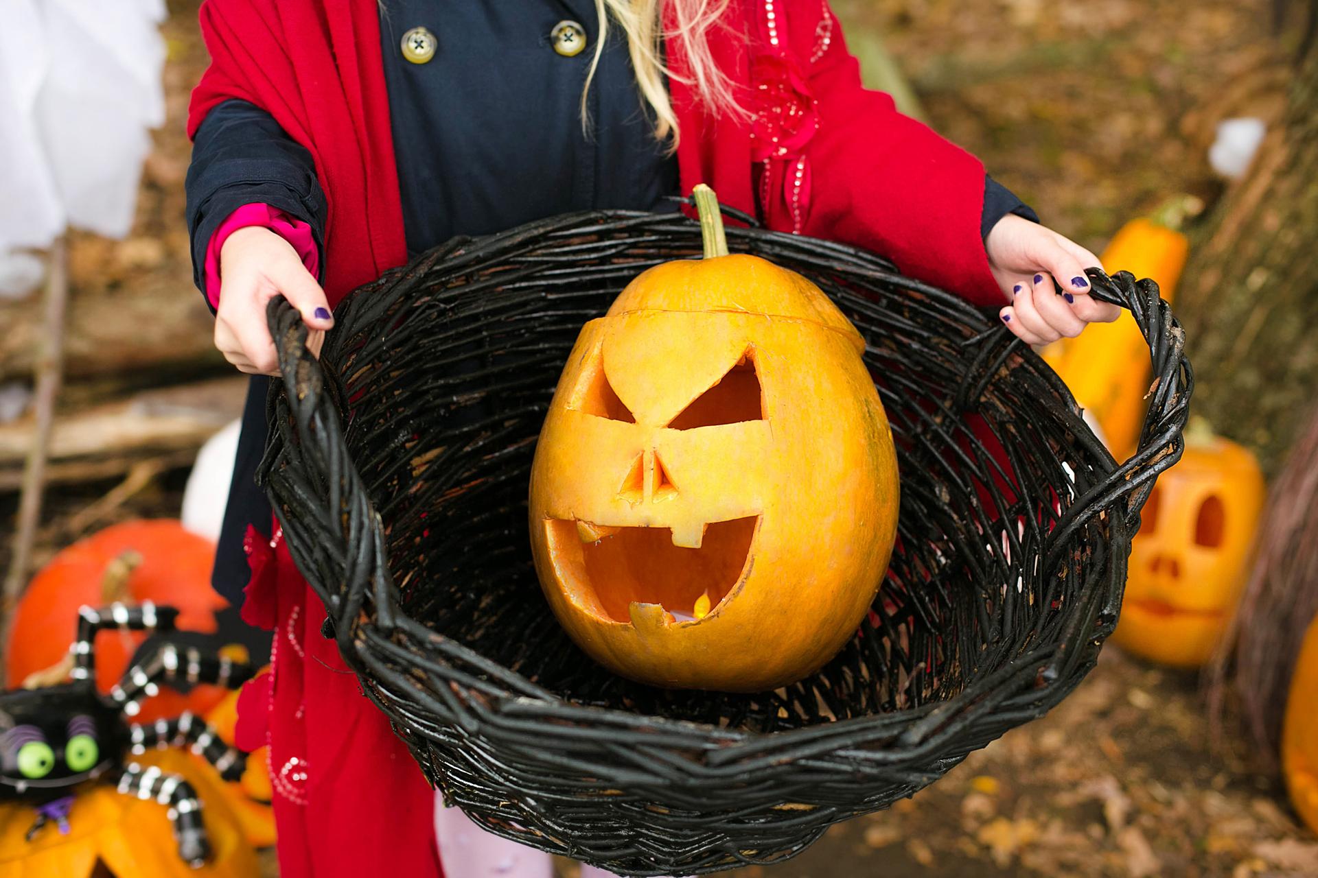 Women holding halloween in basket