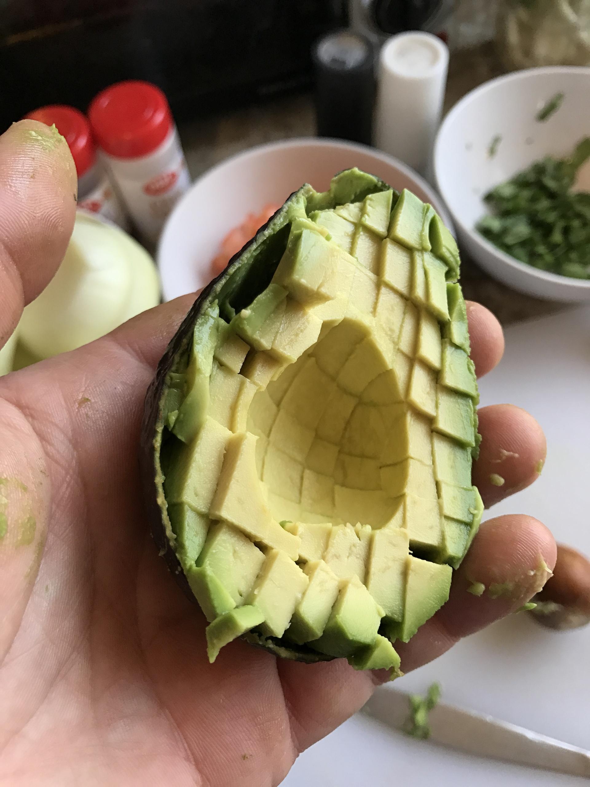 Avocado in hand for guacamole
