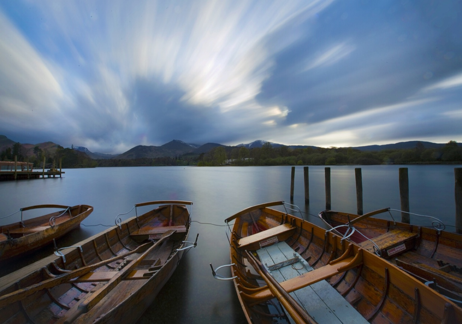 Boats at dusk. End of the day at Derwent Water, Lake District