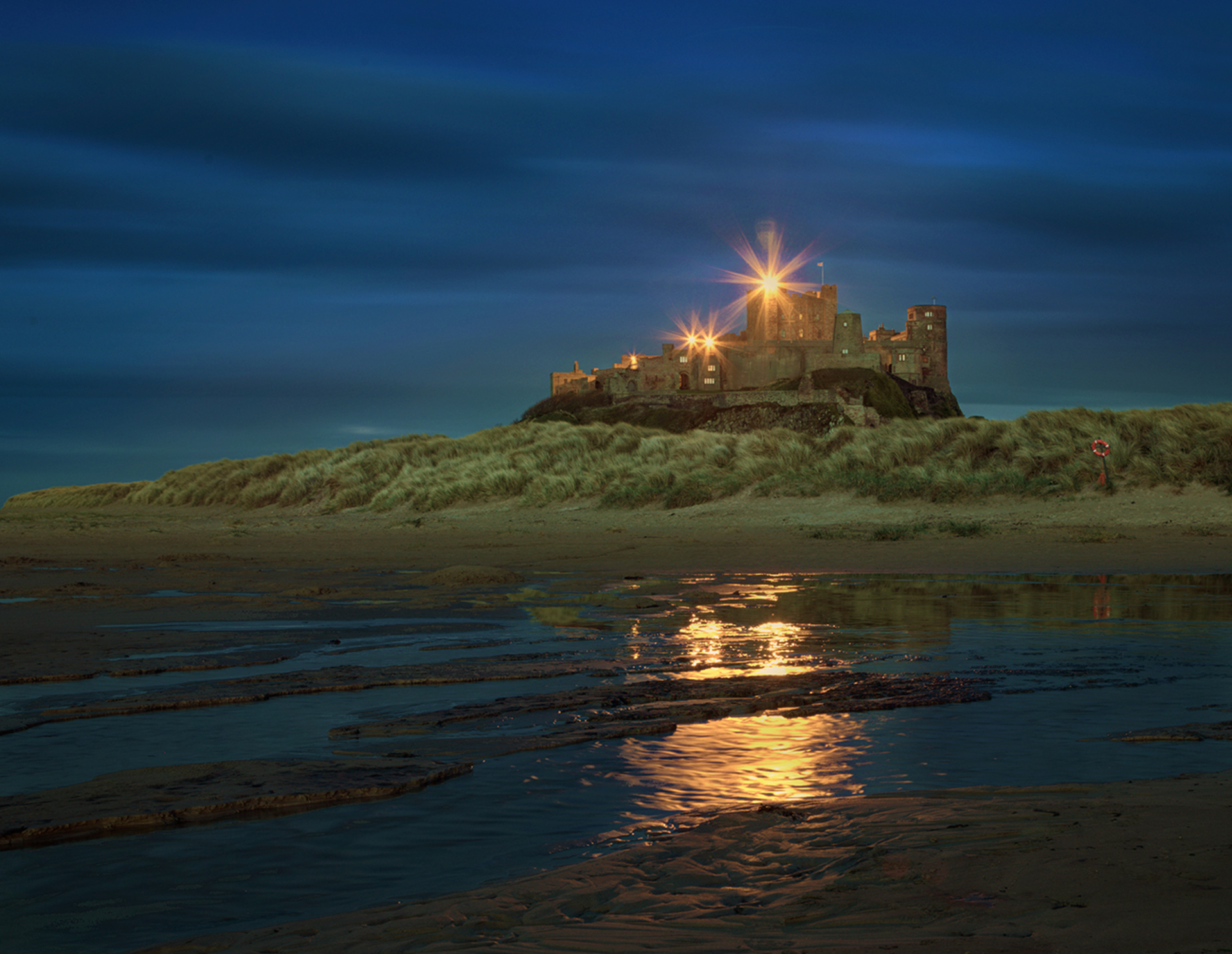 Bamburgh castle sunset. The sun sets on Northumberland's Bamburgh Castle