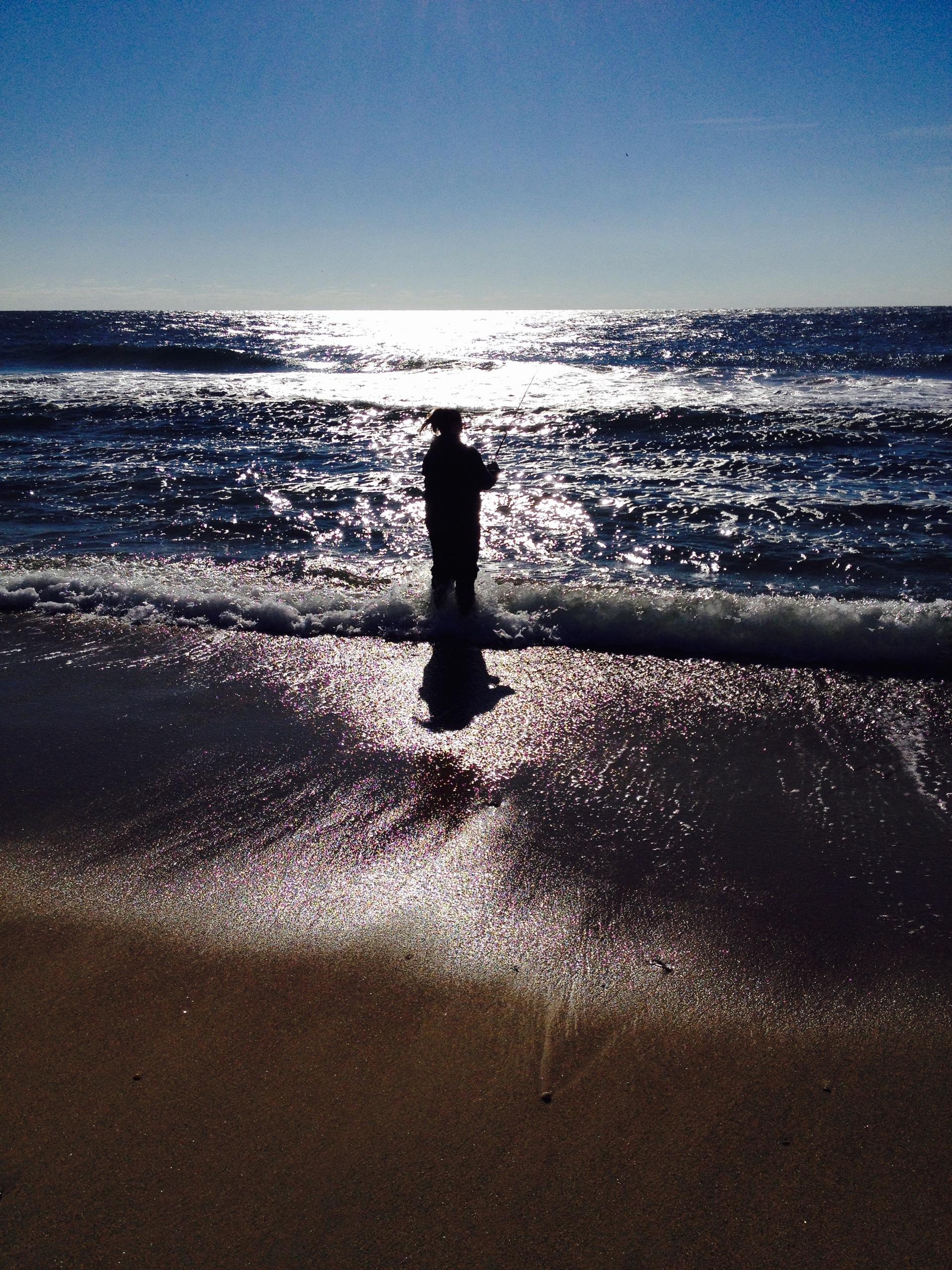 Lonely montauk fisherman solo man fishing at for Montauk ny fishing